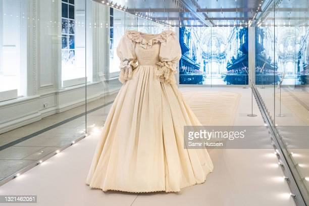 """The wedding dress of Diana, Princess of Wales is displayed during the """"Royal Style In The Making"""" exhibition photocall at Kensington Palace on June..."""