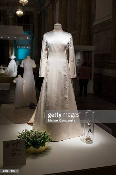 The wedding dress of Queen Silvia of Sweden designed by Marc Bohan is seen on display during an exhibition at the Royal Palace on October 17 2016 in...