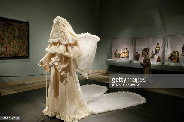 The wedding ensemble dress by Yves Saint Laurent is exhibited during the press preview for the annual fashion exhibition Heavenly Bodies Fashion and...