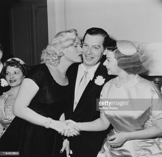 The wedding of American actor and comedian Milton Berle to publicist Ruth Cosgrove , 9th December 1953.