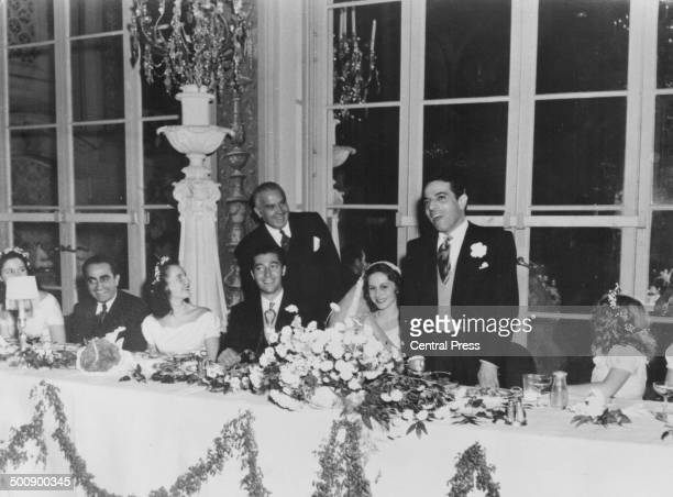 The wedding of businessman Aristotle Onassis and Athina Livanos, as speeches are given during the wedding breakfast, Greece, 1944.