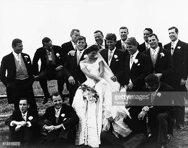 The wedding of John F Kennedy to Jacqueline Bouvier in 1953 Kennedy's brothers Edward and Robert stand by him