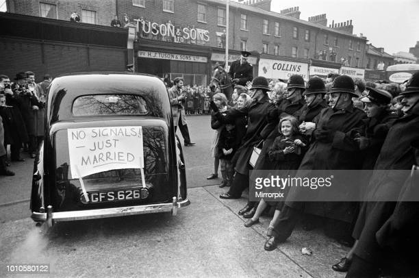 The wedding of Marty Wilde and Joyce Baker held at Christ Church in Greenwich Fans are held back by Police 2nd December 1959