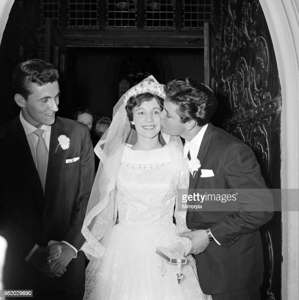 The wedding of Miss Ann Findley and Mr Bruce Welch, Cliff Richard is the best man, pictured kissing the bride. London, August 1959.
