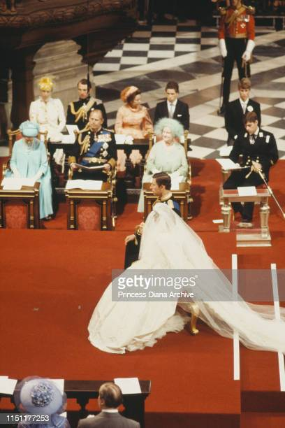 The wedding of Prince Charles and Lady Diana Spencer at St Paul's Cathedral in London, 29th July 1981. Behind the bride and groom are Queen Elizabeth...