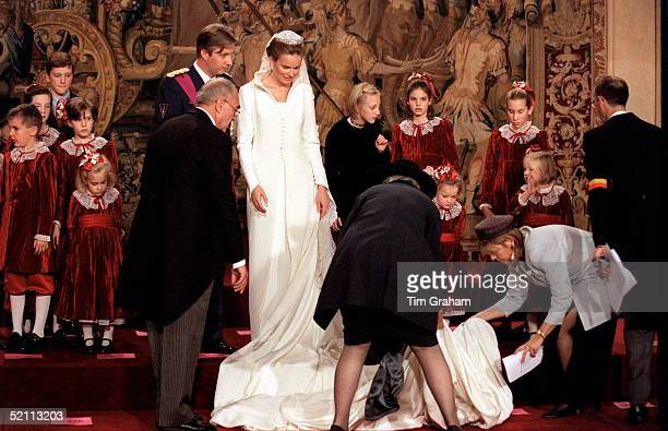 The Wedding Of Prince Philippe Of Belgium And Miss Mathilde D'udekem D'acoz. The Bride Has Help Arranging Her Veil And Train.