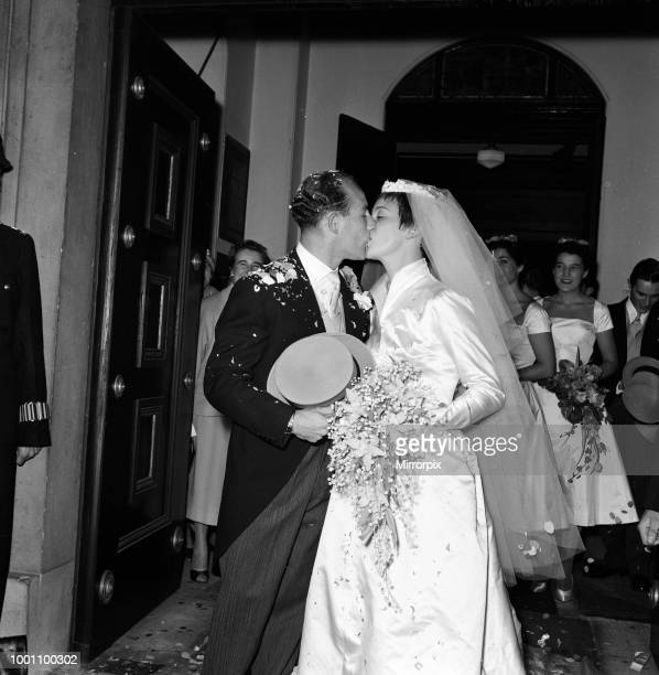 The wedding of Stirling Moss and Katie Molson at St Peter's Church Eaton Square London Pictured the happy couple kissing 7th October 1957