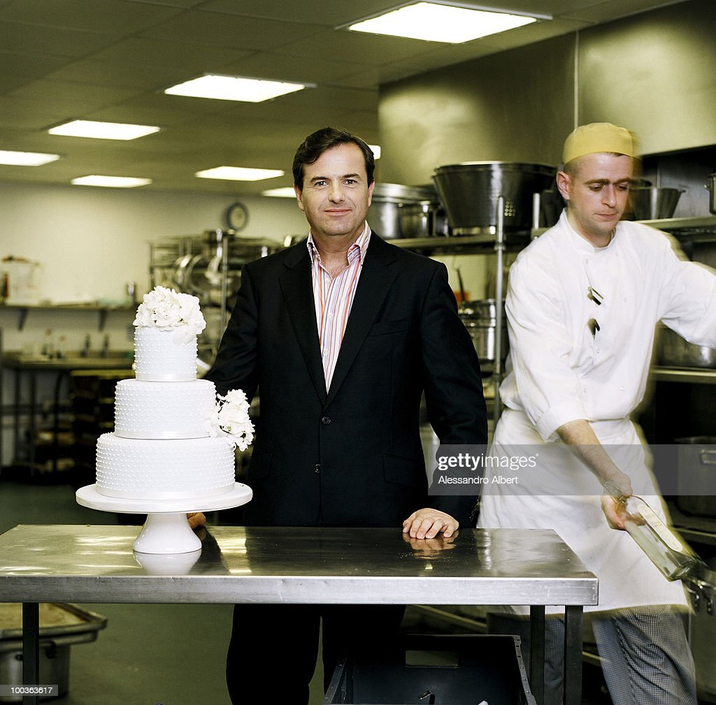 The wedding planner Philip Pleydell Pearce of the agency The Admirable Crichton poses for a portraits session in the kitchen of the agency on December 12, 2007 in London, England