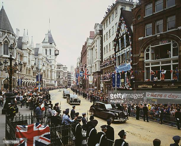The wedding procession of Charles, Prince of Wales, and Lady Diana Spencer passes the Royal Courts of Justice on The Strand, London, 29th July 1981.