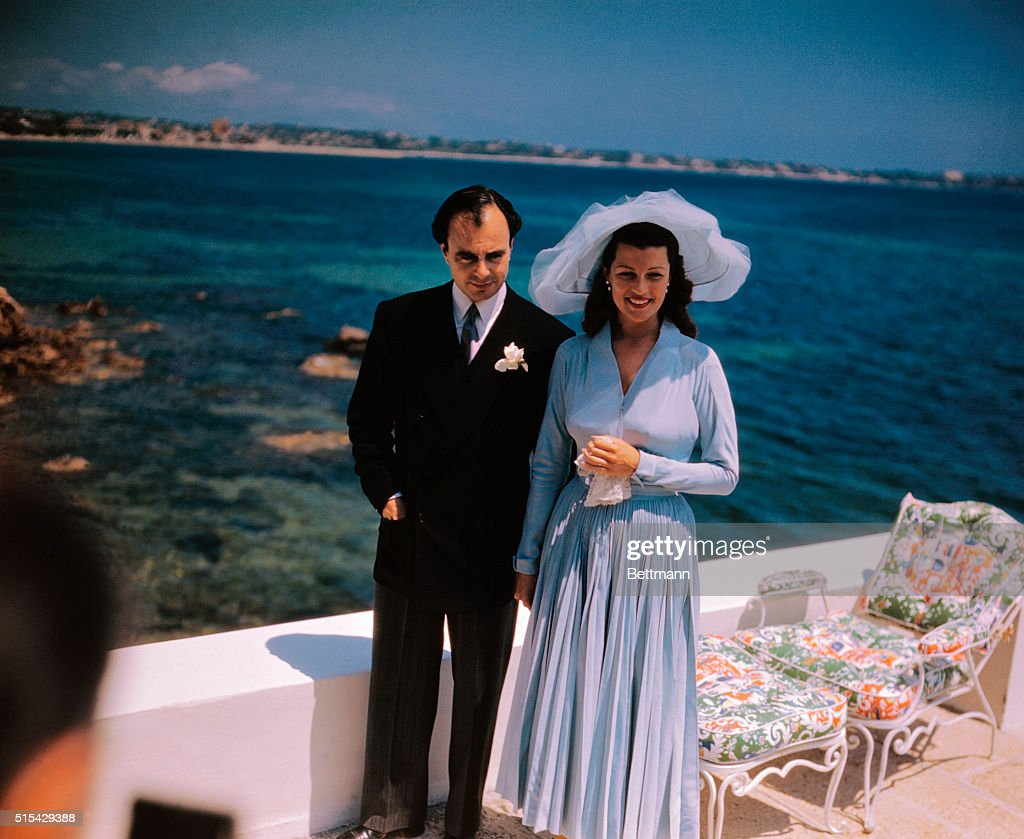Rita Hayworth and Prince Aly Khan Standing on Yacht : News Photo