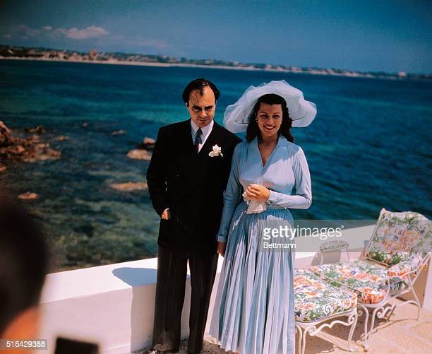 The wedding reception of Prince Aly Khan and Rita Hayworth was held at the Chateau De L'Horizon Here they pose for photo
