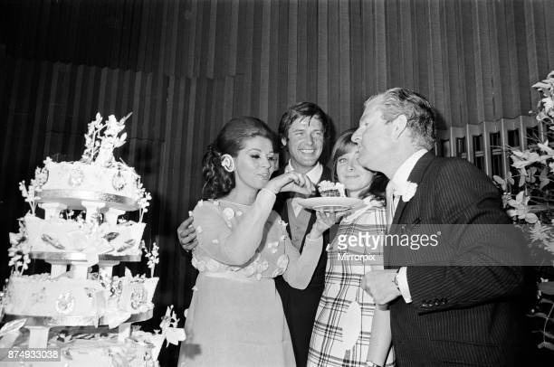 The wedding reception of Roger Moore and Luisa Mattioli at the Royal Garden Hotel, Kensington. The couple are picture with best man Kenneth More and...