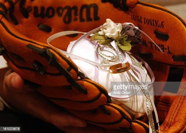 The wedding rings for Kimberly Monroe and James Santaniello were delivered by the ring bearer in a baseball glove at Coors Field Saturday afternoon