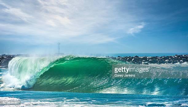 the wedge surf spot, newport beach, california, usa - newport beach california stock photos and pictures