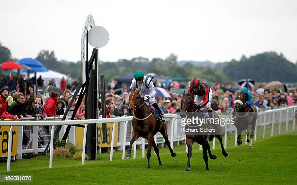 The Wee Barra ridden by Raul Da Silva wins the SIS virtual betting channel handicap stakes race at Ripon racecourse on August 31 2015 in Ripon England