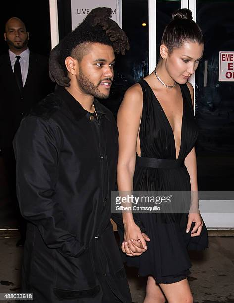 The Weeknd and Bella Hadid are seen leaving Alexander Wang Spring 2016 fashion show afterparty during New York Fashion Week at Pier 94 on September...
