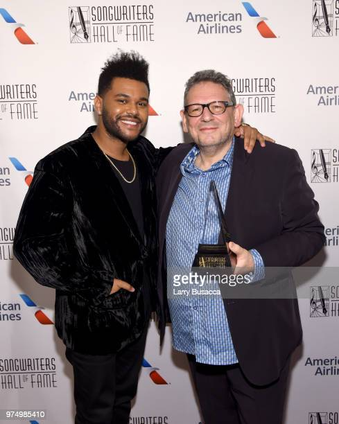 The Weeknd and Howie Richmond Hitmaker Award Honoree Sir Lucian Grainge pose backstage during the Songwriters Hall of Fame 49th Annual Induction and...