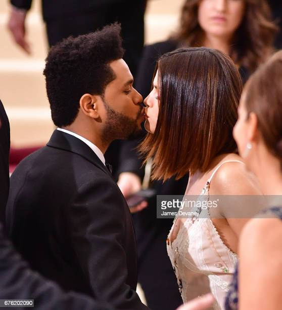 The Weeknd and Selena Gomez kiss at the 'Rei Kawakubo/Comme des Garcons Art Of The InBetween' Costume Institute Gala at Metropolitan Museum of Art on...