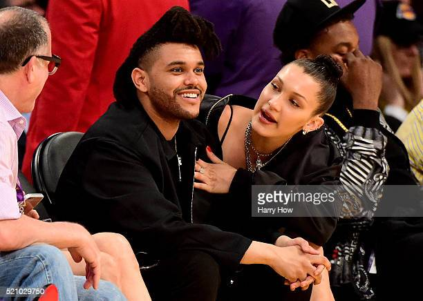 The Weeknd Bella Hadid are seen sitting courtside as the Los Angeles Lakers take on the Utah Jazz at Staples Center on April 13 2016 in Los Angeles...