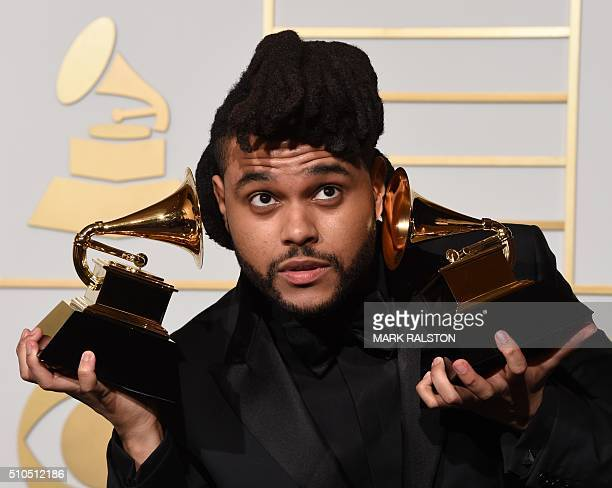 The Weeknd holds his trophies for Best RB Performance and Best Urban Contemporary Album in the press room during the 58th Annual Grammy Music Awards...