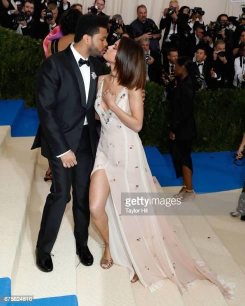 The Weeknd kisses Selena Gomez at 'Rei Kawakubo/Commes Des Garcons Art of the InBetween' the 2017 Costume Institute Benefit at Metropolitan Museum of...