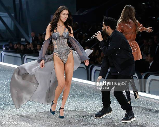The Weeknd performs as Bella Hadid walks the runway during the 2016 Victoria's Secret Fashion Show at Le Grand Palais on November 30 2016 in Paris...
