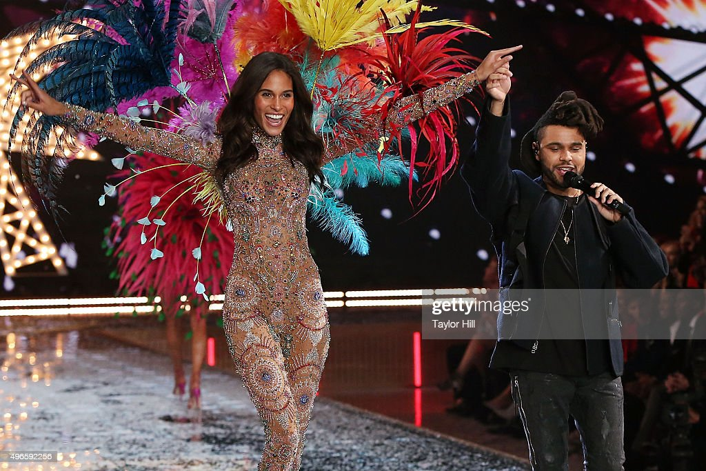 The Weeknd performs as model Cindy Bruna walks the runway at the 2015 Victoria's Secret Fashion Show at Lexington Avenue Armory on November 10, 2015 in New York City.