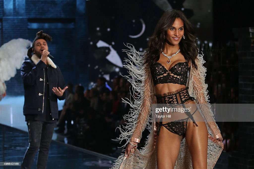 The Weeknd performs as model Cindy Bruna walks the runway during the 2015 Victoria's Secret Fashion Show at Lexington Avenue Armory on November 10, 2015 in New York City.