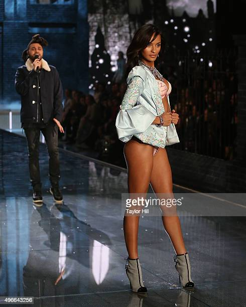 The Weeknd performs as model Gracie Carvalho walks the runway during the 2015 Victoria's Secret Fashion Show at Lexington Avenue Armory on November...