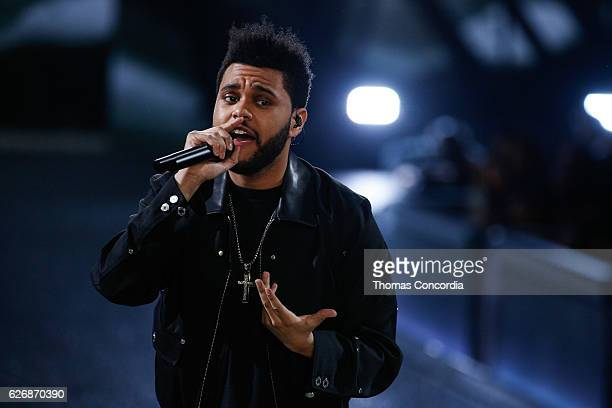 The Weeknd performs on the runway during the 2016 Victoria's Secret Fashion Show at the Grand Palais in Paris on November 30 2016 in Paris France