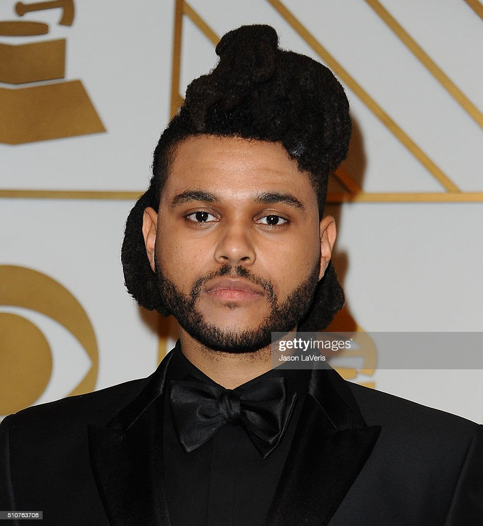 The Weeknd poses in the press room at the The 58th GRAMMY Awards at Staples Center on February 15, 2016 in Los Angeles, California.