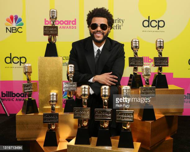 The Weeknd, winner of the Top Artist Award, Top Male Artist Award, Top Hot 100 Artist Award, Top Radio Songs Artist Award, Top R&B Artist Award, Top...