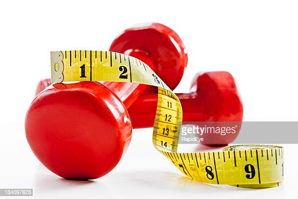 the weighty truth: slimming takes effort! - mass unit of measurement stock pictures, royalty-free photos & images