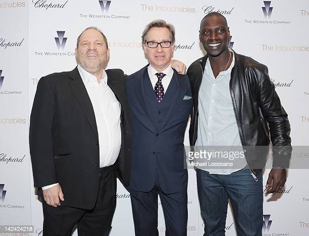 The Weinstein Company CoChairman Harvey Weinstein Paul Feig and actor Omar Sy attend the The Intouchables special screening at MOMA on April 4 2012...
