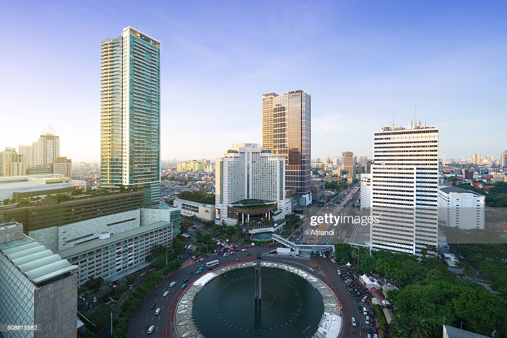 The Welcome Monument, a landmark in Jakarta with city skyline : Stock Photo
