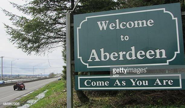 The welcome sign to Aberdeen Washington is seen on April 1 2014 along with the title of a Nirvana song Nirvana fans prepare to mark the 20th...