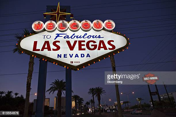The 'Welcome To Fabulous Las Vegas' sign stands at dusk ahead of the third US presidential debate in Las Vegas Nevada US on Tuesday Oct 18 2016 The...