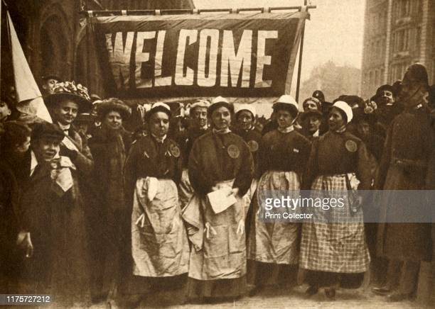 The Welcome to the Victims of Masculine Tyranny' 1908 A group of British suffragettes recently released from prison with a 'Welcome' banner...