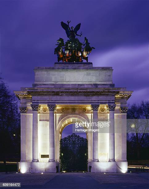 The Wellington Arch, Hyde Park Corner, London, c1990-2010. View of the floodlit arch. Wellington Arch, is a triumphal arch located to the south of...