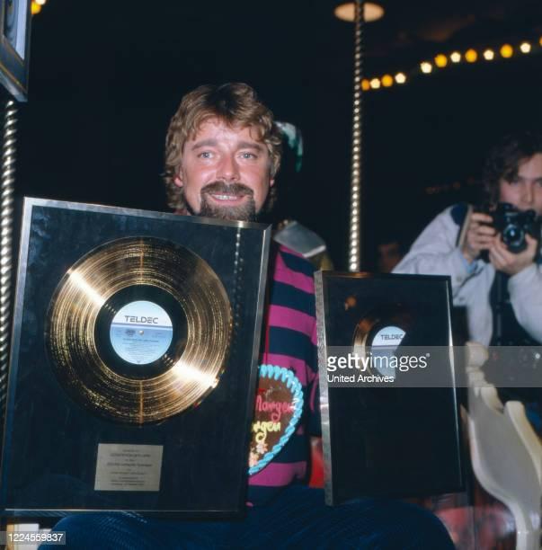 The wellknown German television presenter entertainer actor audiobook speaker musician and comedian Jürgen von der Lippe presents his won gold...