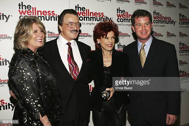 The Wellness Community's executive director Janet Galea and board chairman Jim Cone pose with actor/singer Robert Goulet and wife Vera at The...