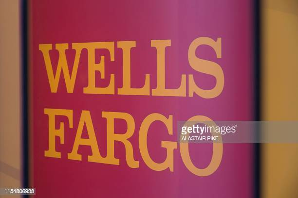 The Wells Fargo logo is seen inside a branch in Washington, DC, on July 9, 2019. - A trio of US banks reported strong profits on July 14 boosted by...
