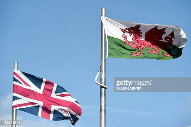 The Welsh and Union flag fly next to each other outside the national assembly building in Cardiff on September 24 2015 AFP PHOTO / DAMIEN MEYER