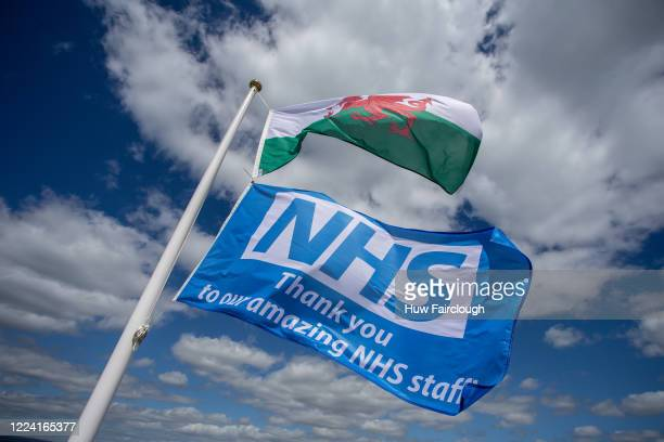 The Welsh Flag and a Blue Flag supporting the NHS flying in the wind at Bryn Meadows Golf Club. Restrictions on Golf have been eased in England but...