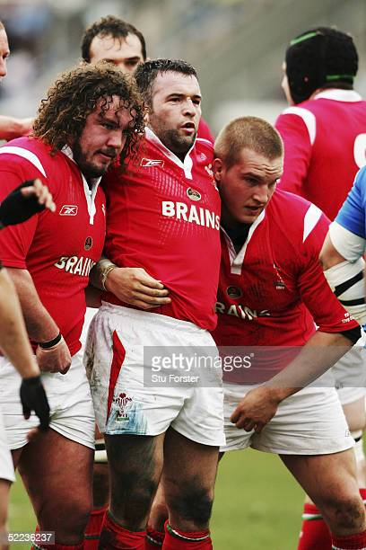 The Welsh front row of Adam Jones Mefin Davies and Gethin Jenkins prepare to scrummage during the RBS Six Nations match between Italy and Wales at...