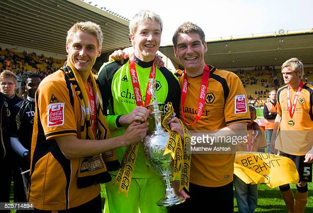 The Welsh Internationals David Edwards Wayne Hennessey and Sam Vokes of Wolverhampton Wanderers with the Coca Cola Football League Championship trophy