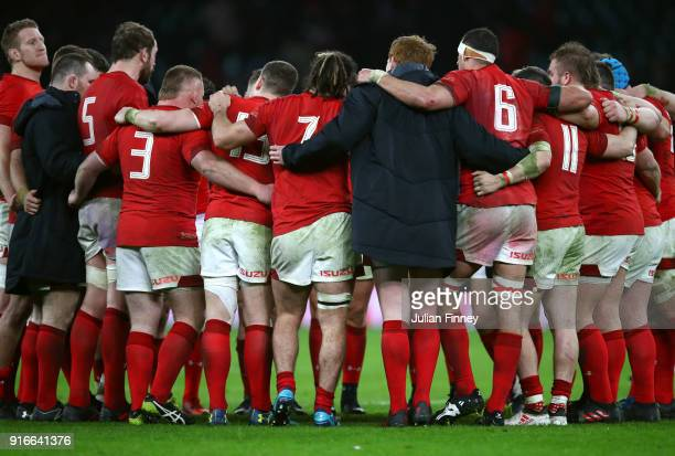 The Welsh players form a team huddle after the NatWest Six Nations round two match between England and Wales at Twickenham Stadium on February 10...