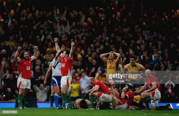 The Welsh team celebrate on the final whistle as the Australians sink to their knees during the Invesco Perpetual Series match between Wales and...