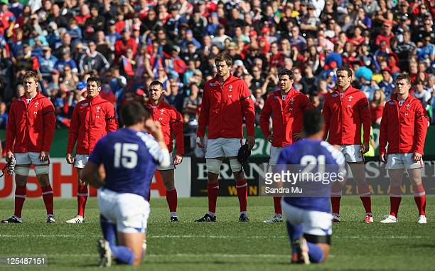 The Welsh team look on as the Samoan team perform the Siva Tau ahead of during the IRB 2011 Rugby World Cup Pool D match between Wales and Samoa at...
