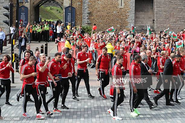 The Welsh team walk out of Cardiff Castle and are welcomed home by fans following their exit from the Euro 2016 championships on July 8 2016 in...